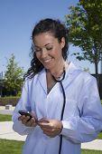 Doctor Female Reading Smartphone