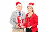 Mature couple posing with Christmas presents isolated on white background