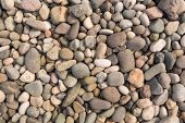 Naturally polished color rock pebbles background