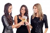 Three friends with sparkling dresses toasting isolated on a white background