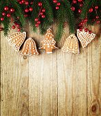 Christmas fir tree with decoration with cookies on a wooden board