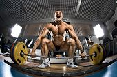 image of bodybuilder  - very brawny guy bodybuilder execute exercise deadlift with weight in gym - JPG