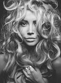 stock photo of perm  - Black and white portrait of eautiful woman with magnificent blond hair - JPG