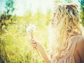 stock photo of romantic  - Outdoor fashion portrait of romantic blonde with dandelions - JPG