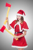Young woman in red santa costume on white