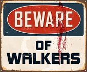 Vintage Metal Sign - Beware of Walkers - Vector EPS10. Grunge effects can be easily removed for a brand new, clean design.
