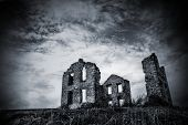 Black and White image of an abandoned stone house