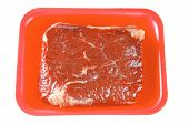 fresh raw beef meat on red tray