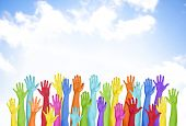 Colorful Hands Raised With Blue Sky