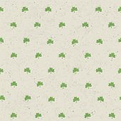Clover leaf seamless pattern on paper texture. Background for St. Patric`s Day. Vector