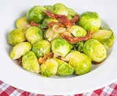 pic of brussels sprouts  - Plateful of halved brussel sprouts cooked with sliced sundried tomatoes and shallot - JPG