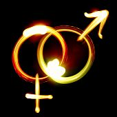 image of hetero  - Male and female symbols created by light - JPG