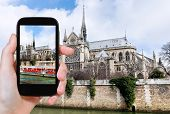 ������, ������: Taking Photo Of Notre Dame Paris And Tourist Boat