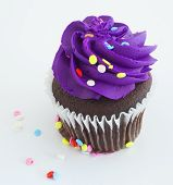 picture of sprinkling  - Chocolate cupcake with sprinkles and purple icing - JPG