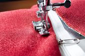 picture of sewing  - sewing a white zipper on a sewing machine. sewing process