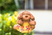 foto of molding clay  - smile baked clay dolls in the garden - JPG