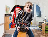 picture of pirate girl  - tow children are  playing in pirates at home - JPG