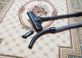 picture of carpet  - carpet vacuuming with vacuum cleaner at home - JPG