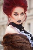 image of gothic hair  - sexy woman with gothic makeup and red hair and castle - JPG
