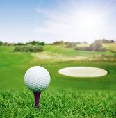 image of landscapes beautiful  - Golf ball on course with beautiful blurry landscape on background - JPG
