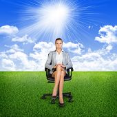 pic of lawn chair  - Woman in jacket sits on chair - JPG