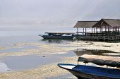 pic of gunung  - Boats on the mountain lake near Gunung Agung volcano in sunrise light - JPG