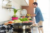 image of vegetarian meal  - Man in kitchen cooking lunch  - JPG