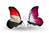 pic of qatar  - Two butterflies with flags on wings as symbol of relations Egypt and Qatar - JPG