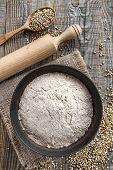 foto of buckwheat  - Buckwheat flour in a bowl on a wooden table - JPG