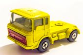 stock photo of truck-cabin  - yellow truck toy isolated on white background