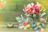 stock photo of leak  - Easter decoration with pink tulips butterflies and colored eggs - JPG