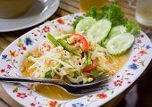"stock photo of thai cuisine  - ""Som tum"" salad in a street restaurant traditional thai cuisine - JPG"