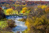 picture of dam  - the root river spills over the lanesboro dam in picturesque lanesboro minnesota autumn - JPG