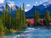 pic of log cabin  - the pipestone river rushes past log cabins in lake louise village banff national park alberta canada - JPG