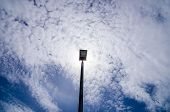 foto of light-pole  - Black Light pole in the blue sky - JPG