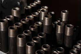 stock photo of nipples  - A tray of iron pipe nipples used for gas plumbing - JPG