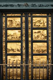 stock photo of adam eve  - Gates of Paradise with Bible stories on door panels of Duomo Baptistry - JPG