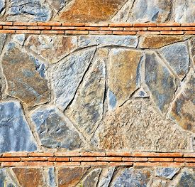 picture of gneiss  - rocks stone and red orange gneiss in the wall of morocco - JPG
