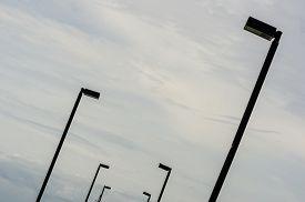 pic of light-pole  - Black Light pole in the blue sky - JPG
