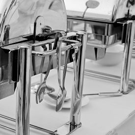 picture of chafing  - Closeup Serving kitchen tongs with chafing dish - JPG