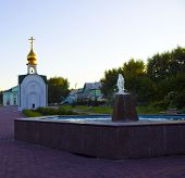 stock photo of chapels  - wonderful recreation area with a chapel and a fountain - JPG