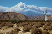 image of sagebrush  - Wildfire smoke coming from a mountain forest fire taken at a wind farm near Palm Springs - JPG