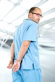 stock photo of handcuffs  - Male doctor in handcuffs isolated in a white backgroud - JPG
