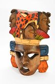 foto of mayan  - Indian Mayan Aztec wooden painted mask with roaring jaguar and human profiles isolated on white background - JPG