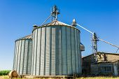 stock photo of silos  - Storage facility cereals silos and drying towers - JPG