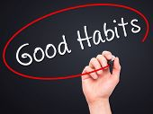 stock photo of  habits  - Man Hand writing Good Habits with black marker on visual screen - JPG