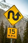 stock photo of curvy  - Curvy road sign an 15 m - JPG