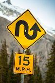 stock photo of curvy  - Curvy road sign an 15 m - JPG