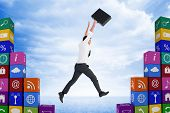 picture of leaping  - Businessman leaping with his briefcase against blue desert landscape - JPG