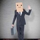 stock photo of anonymous  - Anonymous businessman against grey room - JPG